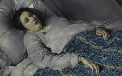 Jeune femme sur son lit de mort